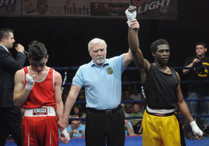 David Lewis in semifinal bout. David Lewis won the 132-pound weight class in the state golden gloves championship.