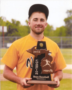 Tyler Helton with the trophy the Tri County baseball team won in 2010. Courtesy photo.