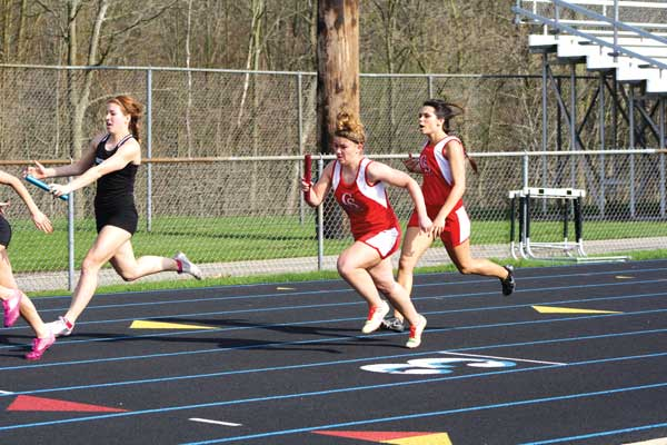 Taylor Vanlangen passes off to Abby VanDusen in the 400 meter relay.