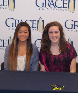 Cedar Springs High School seniors Molly Holtrop (left) and Hannah Wight (right) signed with Grace Bible College last month to play basketball.