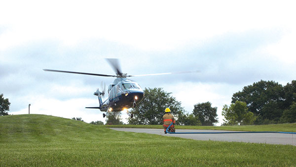 AeroMed landed at the nearby Cedar Chase Golf Course on 17 Mile Road to transport a three-year-old with head injuries to DeVos Children's Hospital Tuesday.  Post photo by L. Allen.