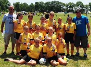 Tri County AYSO U12 girls took third place in the AYSO section 8 state soccer tournament. Back row: Coach Tim Platz, Skylah Wind, Abi Mitz, Makenna Gould, Grace Miller, Paydin Gillespie, Beyonce Anderson and Coach Jason Nagy. Middle row: Taylor Ipema, Morgan Platz, Alison Myers, Karlie Platz. Front row: Macey Matulis, And Mackenzie Hess.
