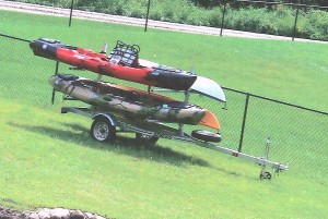 These two kayaks and the trailer they were on were stolen sometime around June 30.