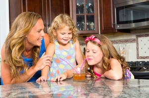 While you can't avoid germs, you can take steps to strengthen your family's immunity and overall health. Soccer champion, Christie Rampone with daughters Reece and Rylie.