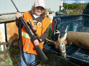 Breanna Duncan and her first deer.