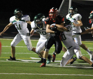 Dux defenders stop a Red Hawk run. Photo by Kelly Alvesteffer.
