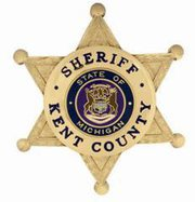 N-Car vs Motorcycle Kent County Sheriff badge