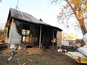 Scott Hammer, 51, the live-in boyfriend of Danielle Scholten-Linderman, 29, reportedly burned the woman's farmhouse in Sheridan that they had been renovating, after he allegedly killed her in a struggle in Spencer Township, Wednesday, October 23. Post photo by L. Allen.