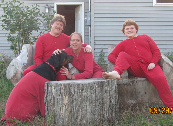 The Corbett family dressed in their Red Flannel finery. Left to right: Ruger (dog), Steve, Lisa, and Mike.