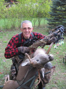 Jack Payne with a recent 2013 buck shot with a weird rack and loaded on the deer cart.