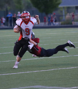 Cedar Springs took a loss against Forest Hills Eastern last Friday night. Here Red Hawk Austin Hilyer is tackled by a FHE Hawk. Photo by Rob LaLone.