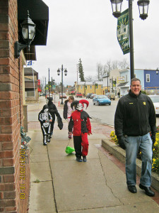 Trick-or-treaters on Main Street during the Spooktacular on Halloween night. Photo from the Cedar Springs Area Chamber of Commerce.