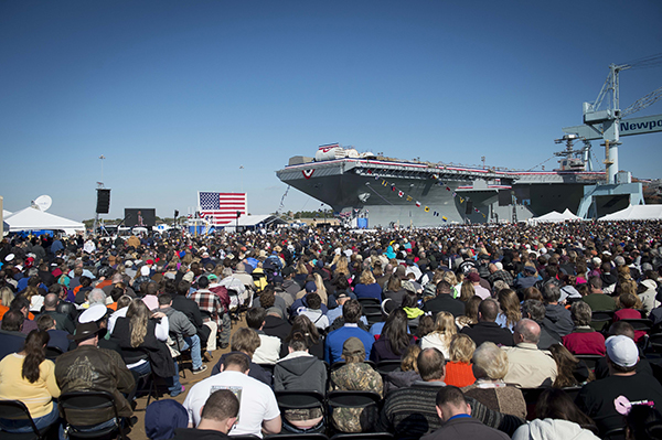 Tens of thousands of Navy supporters attend the christening ceremony of the aircraft carrier Gerald R. Ford (CVN 78) at Newport News Shipbuilding. The first in class, Ford-class aircraft carrier, is scheduled to join the fleet in 2016. (U.S. Navy photo by Chief Mass Communication Specialist Peter D. Lawlor/Released)