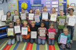 Second grade class with their data binders.