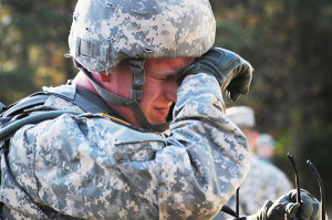 Sgt. Bryan Teneyck wipes his eyes and expresses his frustration during the Recovery Operations task Nov. 20, 2013, which included changing a Humvee tire. He was one of 23 contestants in the 2013 edition of the Army Best Warrior Competition at Fort Lee, Va. Photo by Terrance Bell