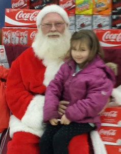 Ceairah Worden with Santa at Family Fare