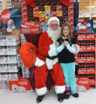 Alaina Austin with Santa at Family Fare
