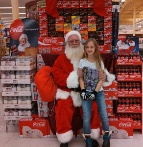 Olivia Austin with Santa at Family Fare
