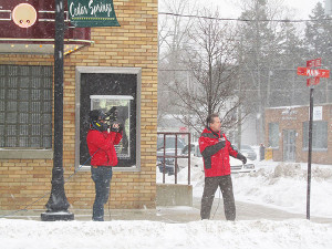 Fox 17 Meteorologist Kevin Craig does the weather from Cedar Springs. Post photo by J. Reed.
