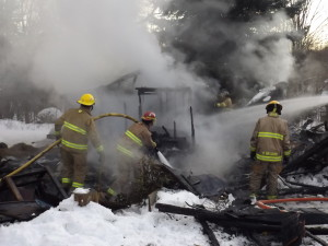 Three departments were called to the scene of this outbuilding that burned directly behind a home in Courtland township Thursday. Post photo by J. Reed.