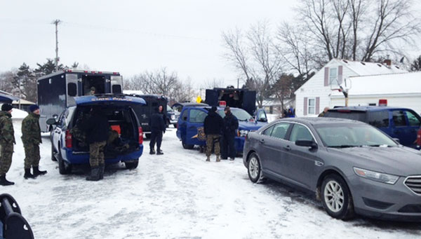 Police descended on a meth lab in Greenville Sunday morning, January 19. Photo courtesy of Woodtv.com.