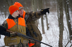 The annual youth rabbit hunt, put on by the Belding Sportsmen's Club and other conservation groups in partnership with the DNR, pairs kids with hunting mentors. Pictured here, Walter Ingvartsen of Ionia (right) offers 14-year-old Cohl Riddle of Vicksburg his guidance.