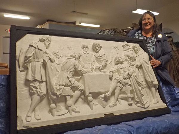 Marie Patin after her work was complete on the 1911 bas relief donated to Hilltop School by the class of 1929. Post photo by J. Reed.