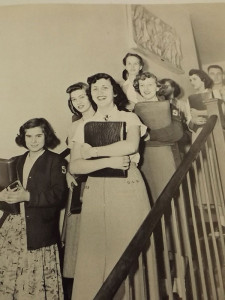 This 1952 yearbook photo shows the sculpture hanging on the wall in the stairwell at Hilltop, with students lined up on the steps.