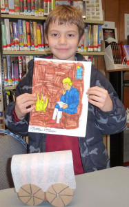 Matthew McQueen shows off his crafts he made at the Library.