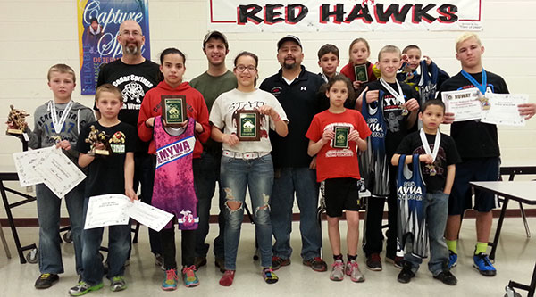 Cedar springs youth state placers and coaches. Missing from photo is Veronica Tapia. Visit Cedar Springs Wrestling on Facebook to follow your local youth and high school champions.