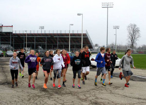 Cedar Springs athletes running on campus