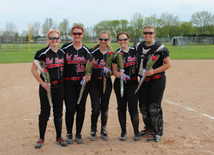 The 2014 senior girls played their last high school softball game. Photo by Robyn Coons