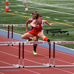 Five Lady Red Hawks won all-conference honors in track, including sophomore Allyson Marvel, shown here in the 100 hurdles.