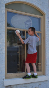 Kids of all ages worked side by side with adults Sunday. Here, Wyatt Fisk washes a window. Photos courtesy of Solon Center Wesleyan.