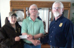 FFA member, Nate Shoen (l) and Advisor Larry Reyburn (r), accept donation from Gleaner Insurance representative Gary Mills (Center).
