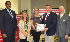 Cedar Springs High School recently received their MI HEARTSafe Schools award. Pictured (L to R) is Kyle Guerrant, Deputy Superintendent Administration and School Support Services for Michigan Department of Education; Tracy Zamarron, MSN RN, Supervisor, Community Nursing Education, School Health Advocacy Program and former Cedar Springs School Nurse; Raquel Ahern, RN Spectrum Health, Cedar Springs School Nurse; Ron Behrenwald, Cedar Springs High School Principal; James K Haveman, Director of Michigan Department of Community Health.