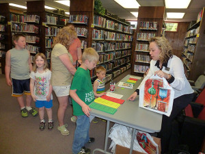 Hundreds of people signed up for the summer reading program Monday.