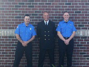 Solon Township Firefighters Russell Papke (left) and Josh Putnam (right) were presented their badges this week by Solon Fire Chief Jeff Drake (center).