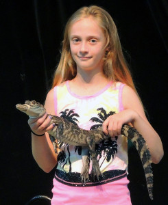 RUN FOR YOUR LIVES! Olivia Austin holding an alligator.