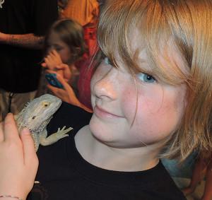 Alexandria Vanderhyde holding a bearded lizard.