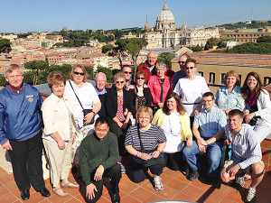 The congregation poses in front of the Vatican.