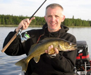 Jack Payne with a walleye caught while slow trolling a Bass Stopper.