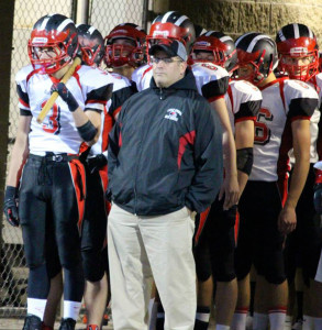Red Hawk Varsity football coach Gus Kapolka at last year's game against Greenville. He has been named the coach of the week by the Detroit Lions. Photo by Kelly Alvesteffer.