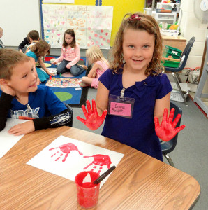 Kindergartner Emma Barger shows off her painted hands. Courtesy photo.