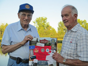 Jack Clark (left ) presents door prize to Art Probst (right)