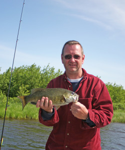 John Huyser with a small mouth bass caught on a crawler and a spinner.