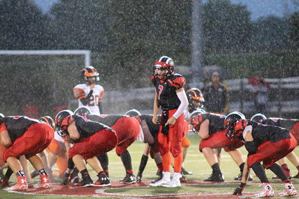 The Red Hawks blazed a trail to the endzone against Belding last week, even in the pouring rain. Photo from Kelly Alvesteffer.