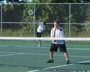 Red Hawk #3 doubles team Nick Hibbs (freshman) serving the ball and Jared Liggett (sophomore) waiting for the return.