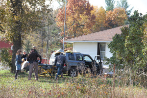 The driver who crashed into this home on 14 Mile Road Monday may have suffered a medical emergency. Photo courtesy of the Rockford Squire.