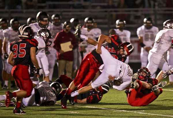 Red Hawk MavRick Cotten takes down the Eastern Hawks' ball carrier. Photo by R. LaLone.